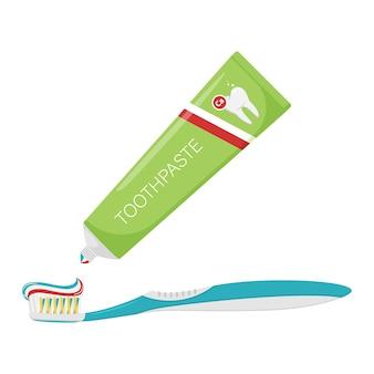Zahnpasta wird aus der tube auf die zahnbürste gedrückt
