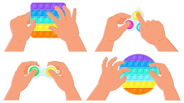 Zappeln sie einfache grübchen und knallen sie es mit spielzeug. kinderhände halten silikonblasen sensorisches spielzeug vektor-illustration-set. antistress pop it und einfaches spielzeug. fidget-spielblase aus silikon, spielzeugfinger in kinderhand