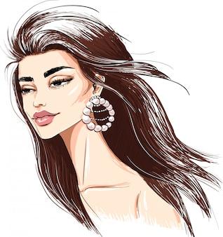 Zarte frau mit perlenohrring und windigem haar