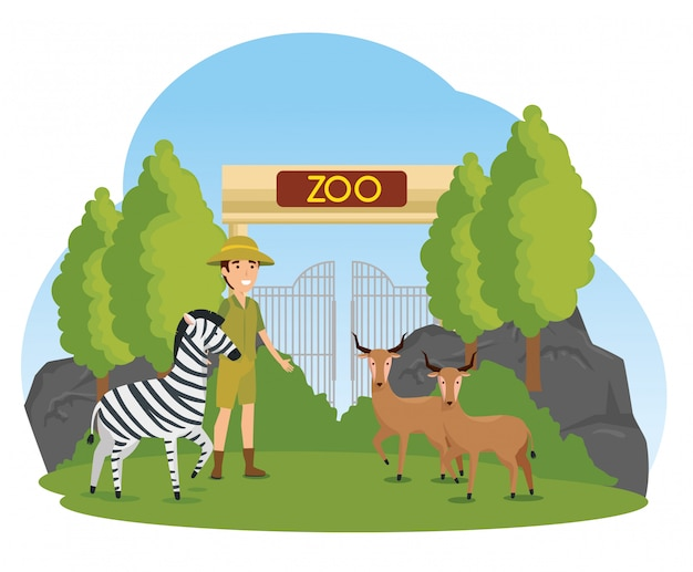 Zebra mit rotwildtieren im zoo mit safari-mann
