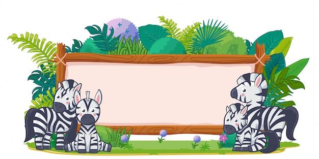 Zebras mit einem leeren zeichenholz