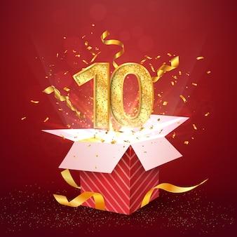 Zehnjähriges jubiläum und offene geschenkbox mit explosionen konfetti isoliert designelement