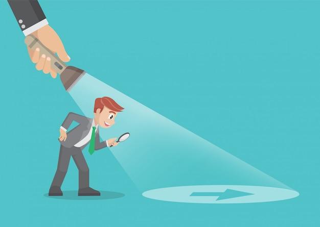 Zeichentrickfilm-figur wirft, illustration eines geschäftsmannes auf, der von einer hand geführt wird, die eine taschenlampe hält, die pfeilzeichen aufdeckt. geschäftskonzept.