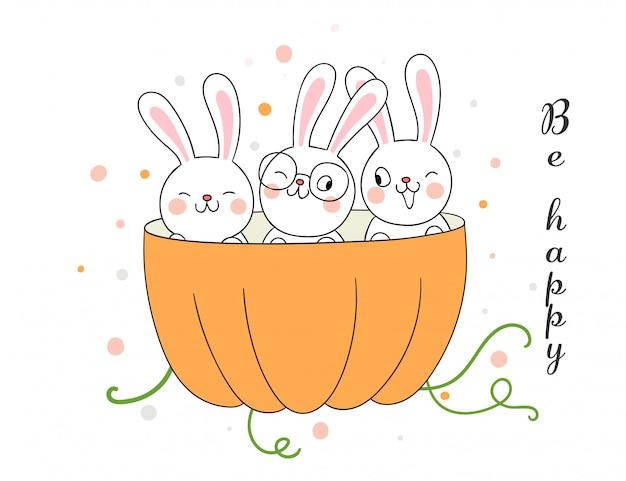 Zeichnen sie kaninchen in kürbis für die herbstsaison.