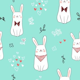 Zeichnen sie niedliches kaninchen des nahtlosen musters auf grün