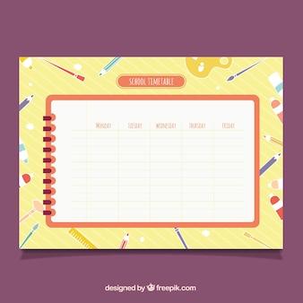 Zeitplan auf spirale notebook mit spaß hintergrund Kostenlosen Vektoren