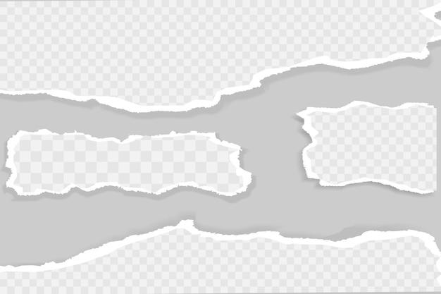 Zerrissene, zerrissene weiße und graue papierstücke mit weichem schatten.