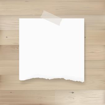 Zerrissener papierhintergrund auf holz.
