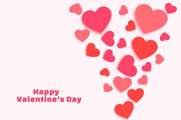 Zerstreute valentinstagherzen in den schatten der rosa grußkarte