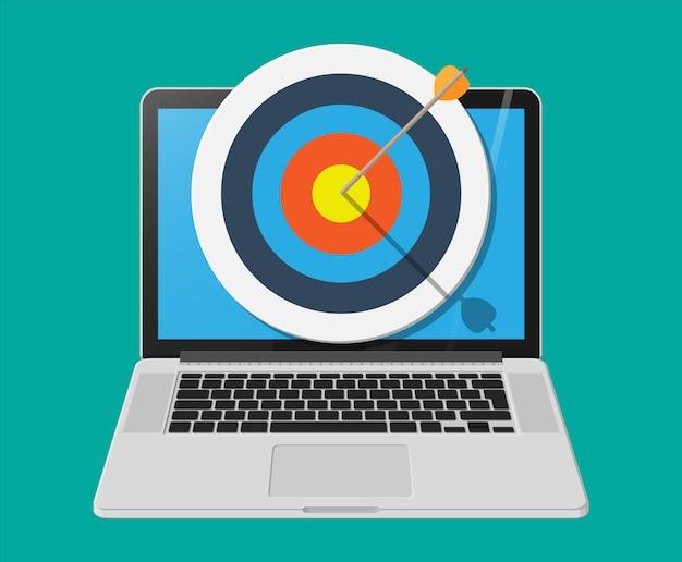 Ziel mit pfeil in der mitte auf dem laptop-bildschirm Premium Vektoren