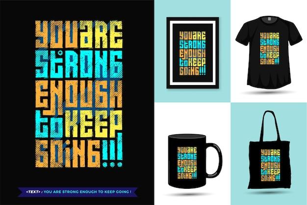 Zitat t-shirt sie sind stark genug, um weiterzumachen. vertikale design-warenvorlage der trendigen typografie