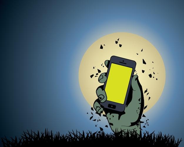 Zombie hand hält das telefon im mondlicht