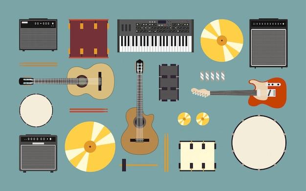 Zu den musikinstrumenten gehören gitarre, trommel, verstärker und keyboard im flachen icon-design