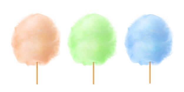 Zuckerwatte-set. realistische orange, grüne, blaue zuckerwatte auf holzstäbchen. sommer leckerer und süßer snack für kinder.