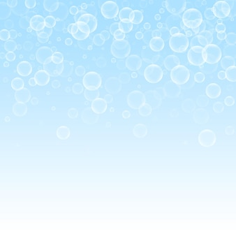 Zufällige seifenblasen abstrakten hintergrund. blasen auf winterhimmelhintergrund. fette seifenschaum-overlay-vorlage. frische vektorillustration.