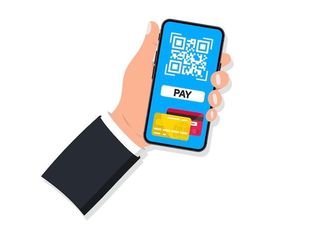 Zum bezahlen scannen. zahlung per kreditkarte mit smartphone zum scannen des qr-codes. hand hält smartphone mit qr-code-scanner. konzept kontaktloses bezahlen, online-shopping, bargeldlose technologie