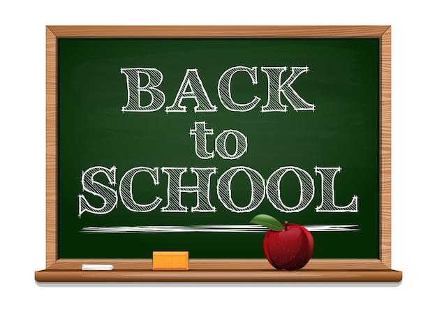 Zurück zum schulhintergrund. kreide auf einer tafel - zurück zur schule. schwarze tafel. roter apfel auf einem tafelhintergrund.