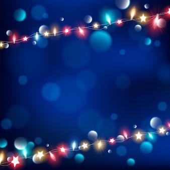 Zusammenfassung von lichterketten auf dunkelblauem hintergrund