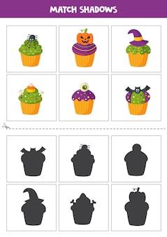 Zusammenpassende karten des schattens für vorschulkinder. halloween-cupcakes.