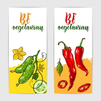 Zwei bunte banner mit gesunder gurke und chili-pfeffer