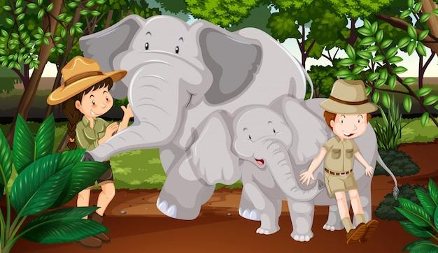 Zwei elefanten und kinder im wald