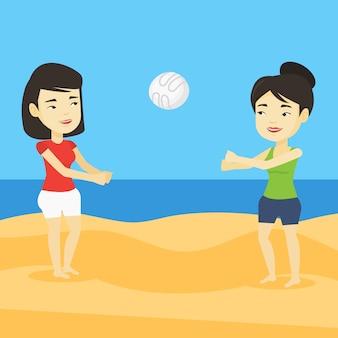 Zwei frauen, die beachvolleyball spielen.