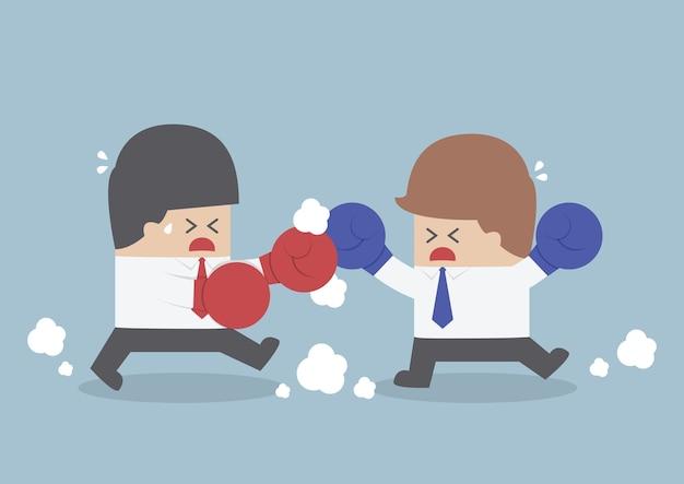 Zwei geschäftsmänner, die einen kampf mit boxhandschuhen haben