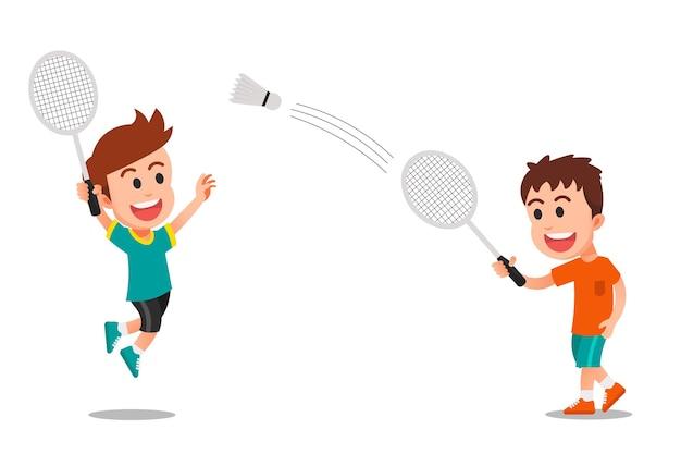 Zwei glückliche jungs, die badminton spielen