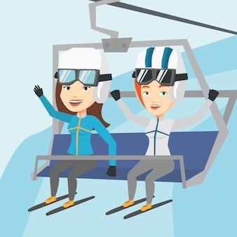 Zwei glückliche skifahrer mit der seilbahn im skigebiet.