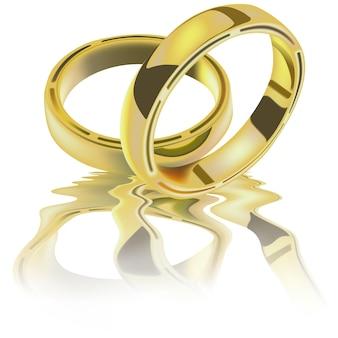 Zwei goldene eheringe auf einer welligen reflektierenden oberfläche