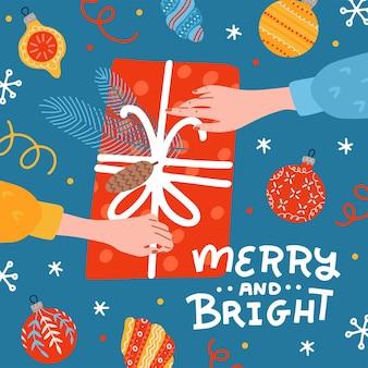 Zwei hände halten und auspacken dekorierte geschenkbox weihnachtsgeschenk draufsicht konzept weihnachtszeit...