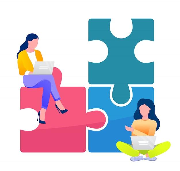 Zwei isolierte geschäftsfrauen mit laptops, die am gemeinsamen geschäftsprojekt arbeiten, sitzen am puzzle und nahe
