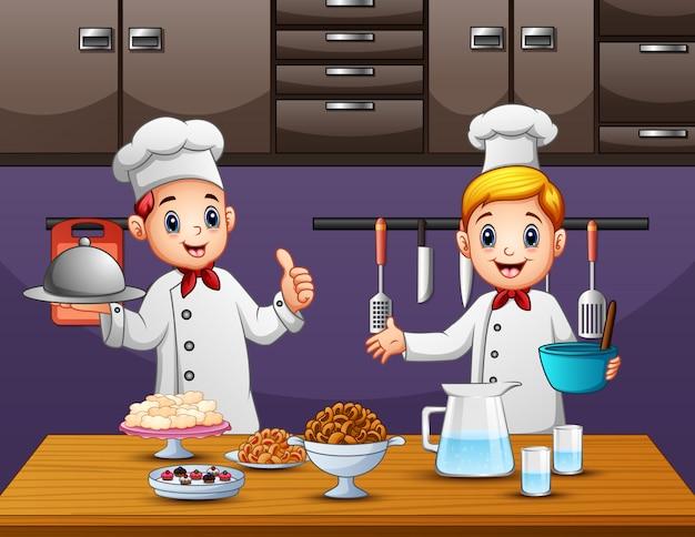 Zwei junge köche, die essen in der küche zubereiten