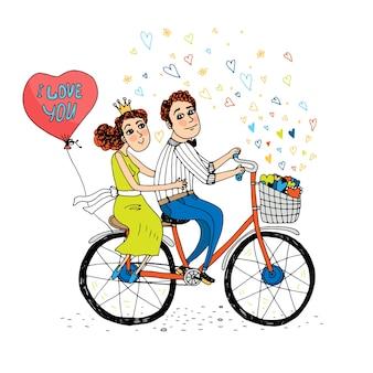Zwei junge liebhaber, die ein tandemfahrrad mit einem roten herzförmigen ballon mit den wörtern fahren