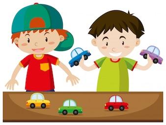 Zwei Jungs spielen mit Autos