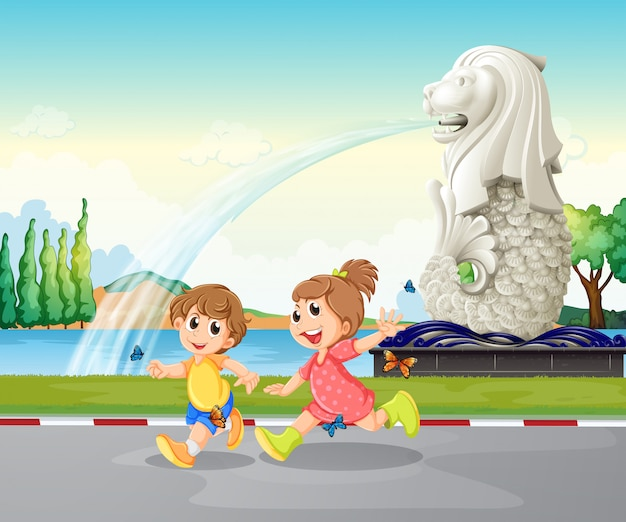 Zwei kinder, die nahe der statue von merlion spielen