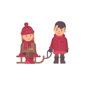 Zwei kinder in der winterkleidung, die einen schlitten reitet