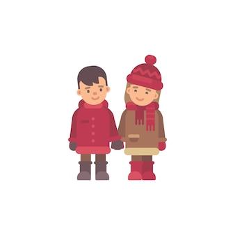 Zwei kinder in der winterkleidung, die hände anhält