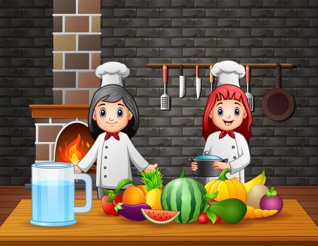 Zwei köche bereiten am esstisch essen zu