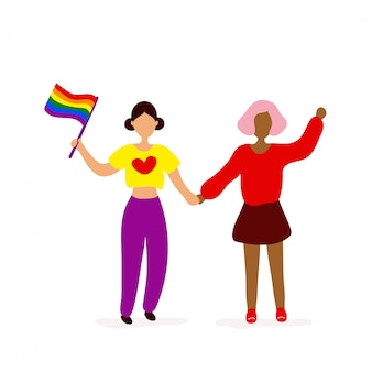 Zwei lesben mit regenbogenfahne, die hände halten
