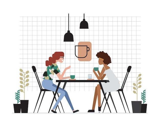 Zwei mädchen oder ein paar freundinnen sitzen am tisch, trinken kaffee und reden. freundliches treffen und gespräch im café. süße zeichentrickfiguren. bunte vektorillustration im flachen stil