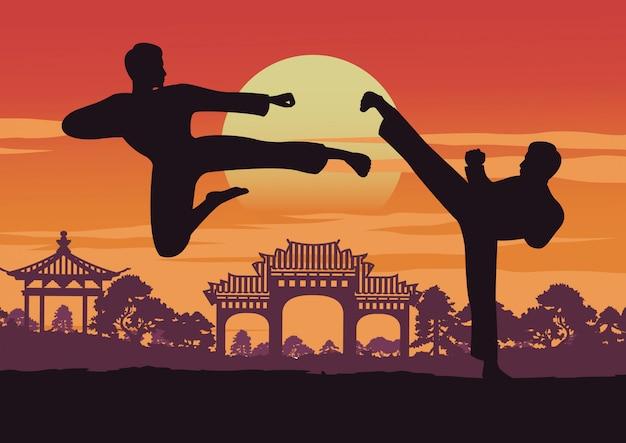 Zwei männer bilden taekwondo in der nähe von wahrzeichen von korea aus