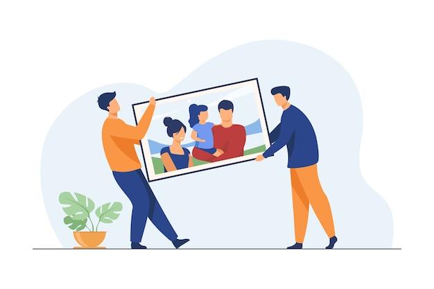 Zwei männer mit großem familienbild. leute, die in neue wohnung flache vektorillustration bewegen. grafik, erinnerung, familienporträt