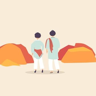 Zwei männliche pilger gehen in die berge