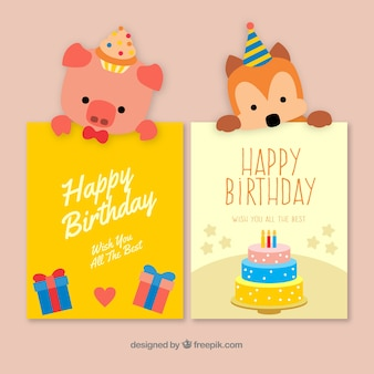 Zwei nette Hand gezeichnete Geburtstagskarten mit einem Hund und einem Schwein