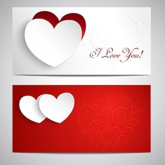 Zwei postkarten mit herzen, muster und den worten ich liebe dich.