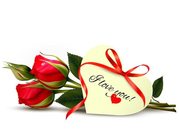 Zwei rote rosen mit einer i love you note.