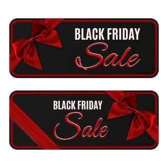 Zwei schwarze freitag-verkaufsbanner. geschenkkarte, broschüre oder plakatvorlagen mit rotem band und schleife.