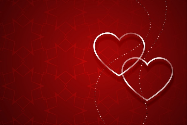 Zwei silberne herzen auf rotem valentinstaghintergrund
