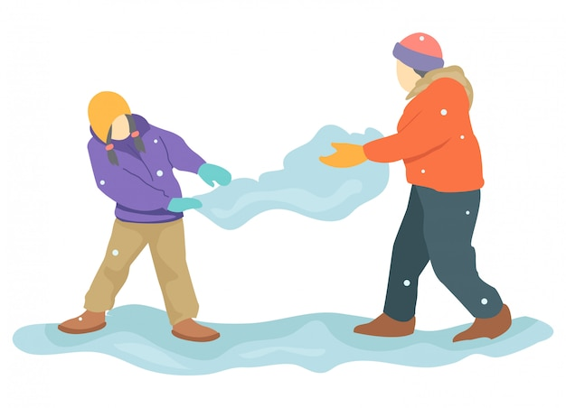 Zwei teenager spielen im winter schnee.